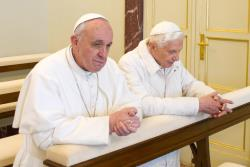 Pope Francis and Pope Emeritus Benedict XVI praying together: images obtained from www.news.va