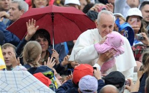 Pope Francis stops to bless this child.  Photo provided by the EPA